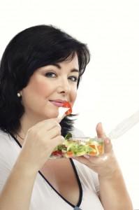 Woman eating healthy vegetable salad