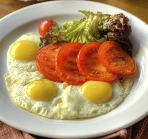Fried eggs with roasted tomatoes