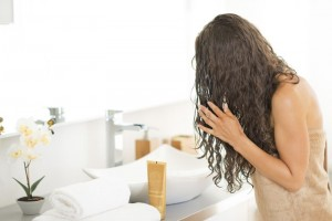 Young woman with wet hairs in bathroom