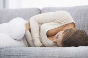 Feeling bad young woman laying on sofa